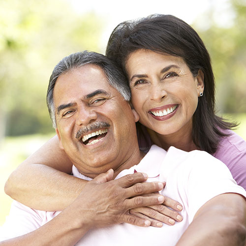 mature couple laughing together